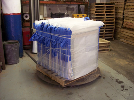 Flood barriers packaged seven systems per pallet for shipping